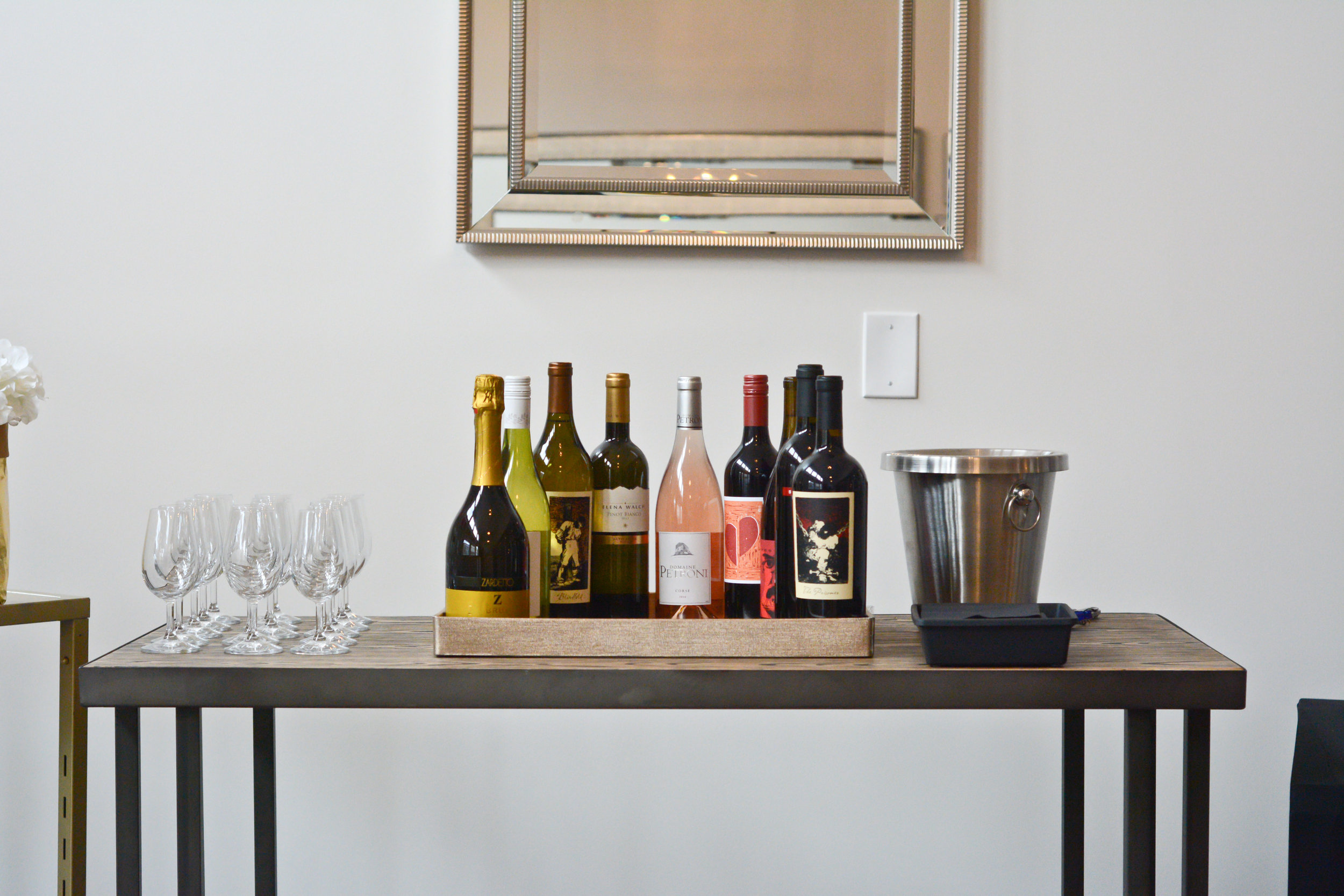 Corks-and-Cuvée-Shoppe-Wine-Table-Showcase