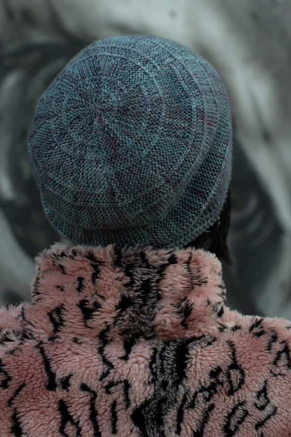 Circled 1, featuring offset arcs. Slouchy Hat pattern ideal for variegated sock yarn
