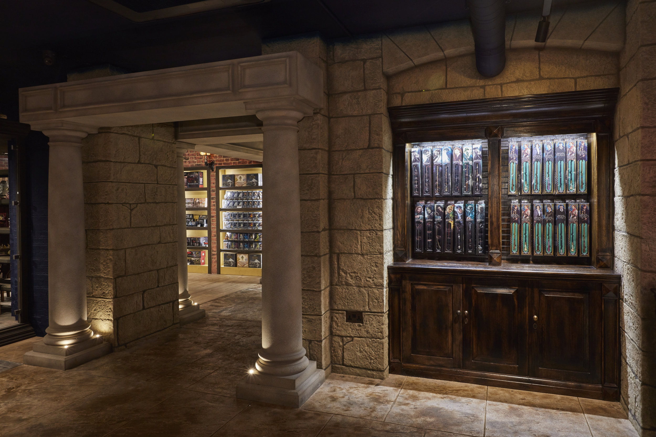 Propability, Noble Collection, Castle area, York stone walls, LED lit display cases, immersive environment.jpg