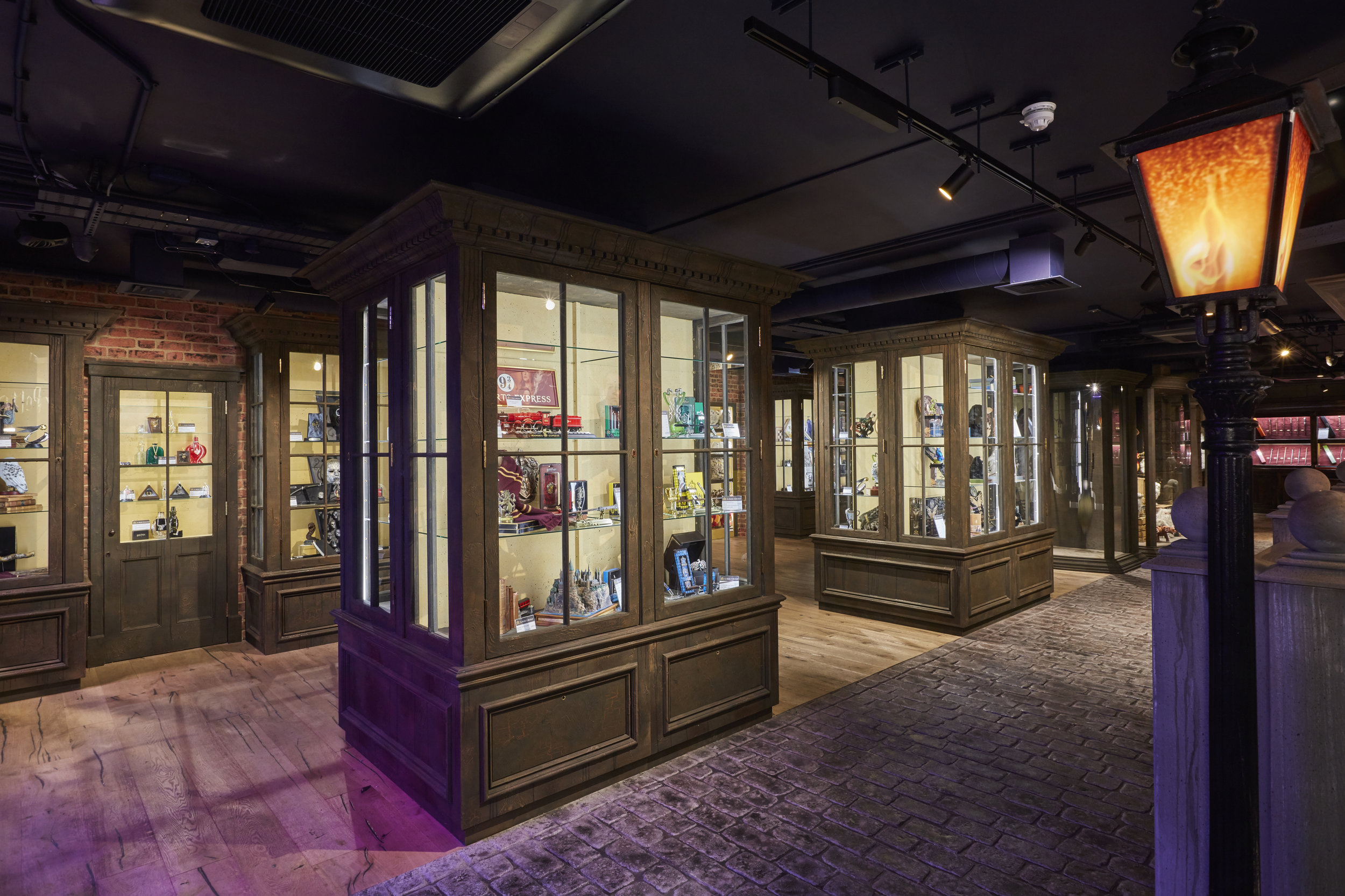 Propability,  Noble Collection, Victorian lamp, street scene, immersive retail, dispaly cases, brick work, woo.jpg
