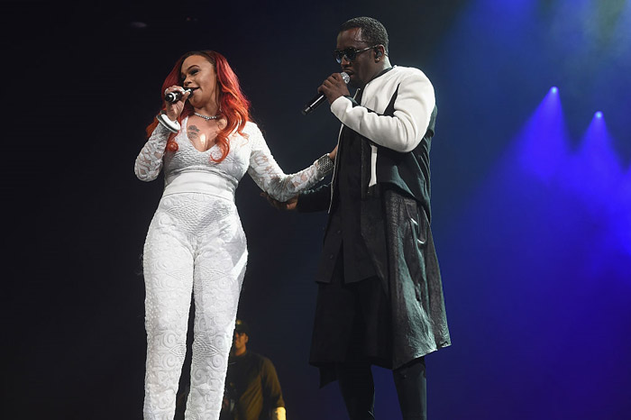 Faith and Diddy share a moment together on stage.
