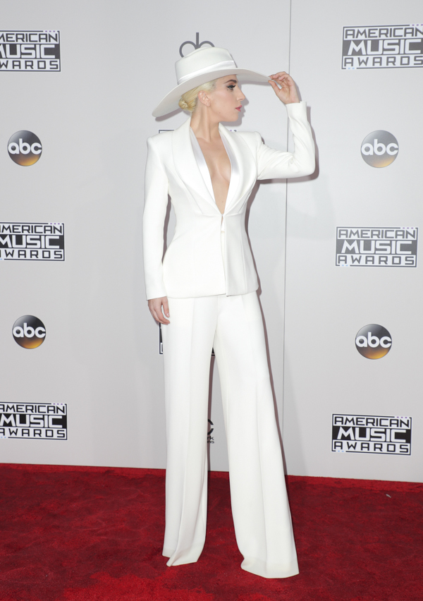 Ever the artist, Lady Gaga shows a subtle nod to the times in a Brandon Maxwell pantsuit in white, the typical color suffragettes wore during protests.