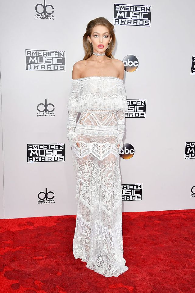 Skip the holidays, Gigi has us ready for beachy vacation days in this Roberto Cavalli white lace gown.