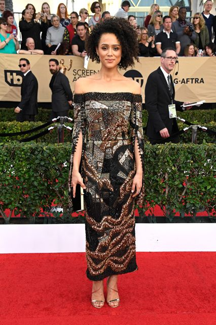 Nathalie Emmanuel's curls are popping and she's right on trend with a J. Mendel off the shoulder beaded number.