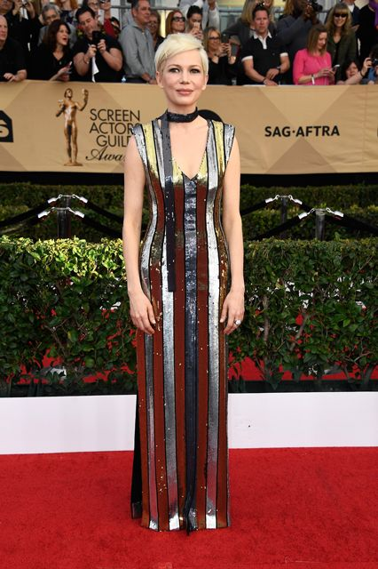 Michelle Williams also channeled the 20s in a beautiful metallic beaded Louis Vuitton dress.