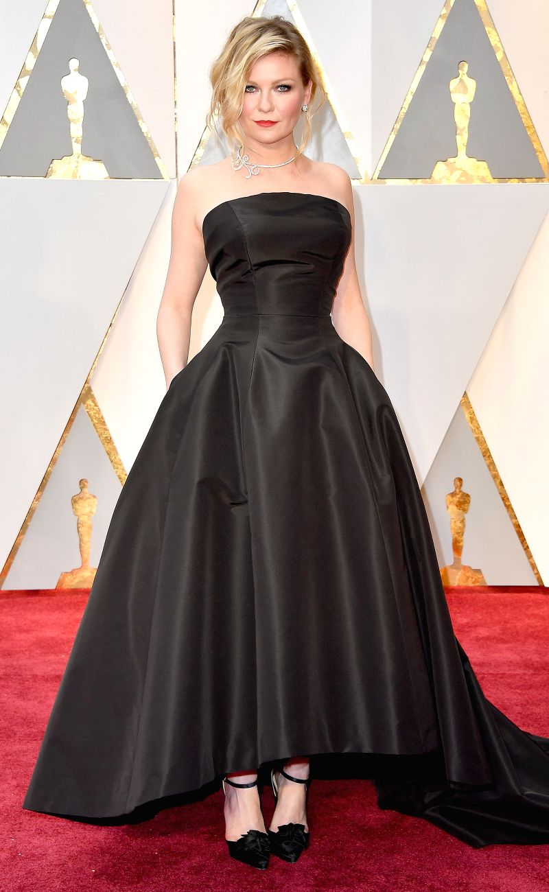 Kirsten Dunst dazzles in the epitome of a beautiful LBD with a train for the red carpet in Dior Haute Couture. In Dior's classic shape, this is an investment piece that sans train, can be work for ANYTHING.
