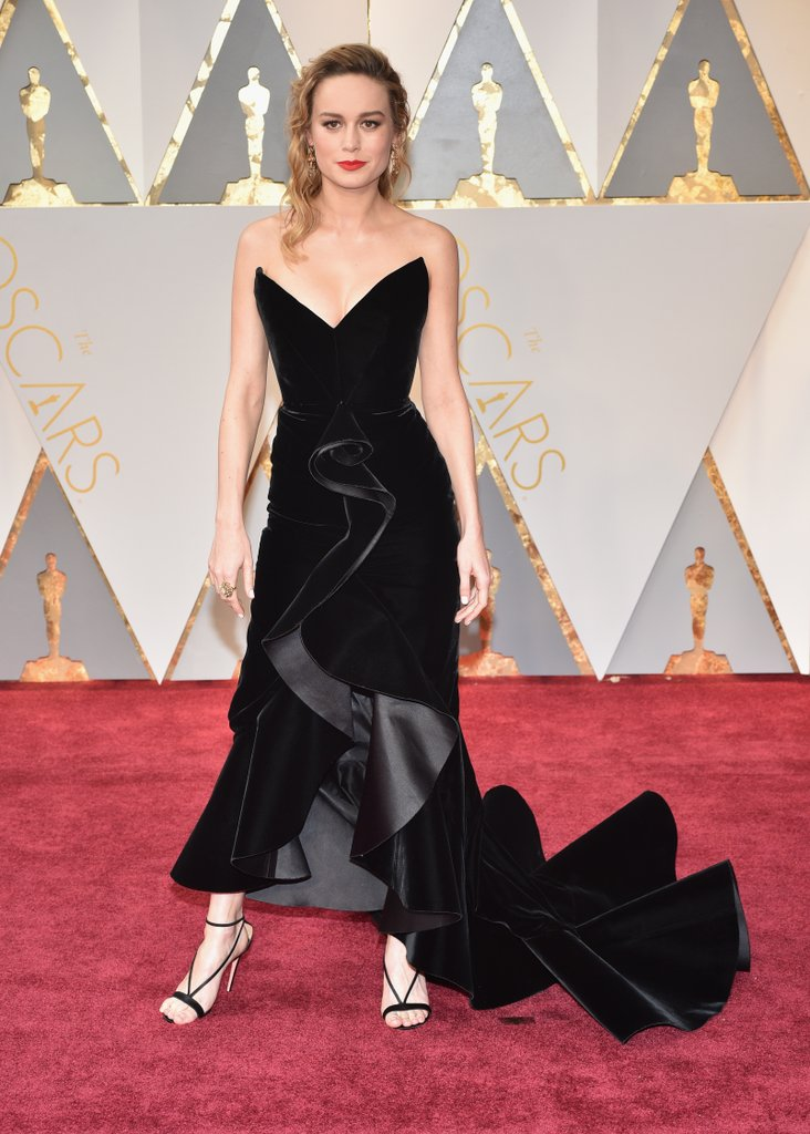Brie Larson also takes the classic LBD to the next level with her Oscar de la Renta gown and Aquazurra shoes.