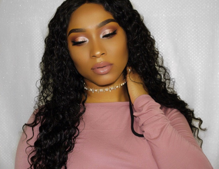 Our gorgeous Indique Soho Client Care Liaison,Khadeen, is wearing  Indique's PURE Curly  hair with a Curly Closure!