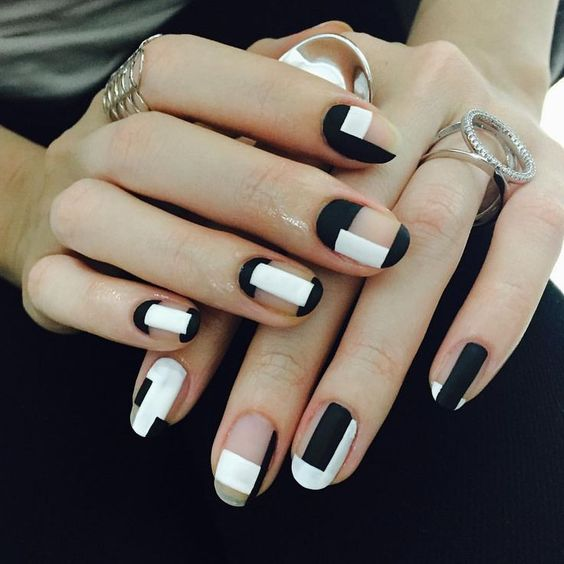 09-matte-black-and-white-negative-space-geometric-nails.jpg