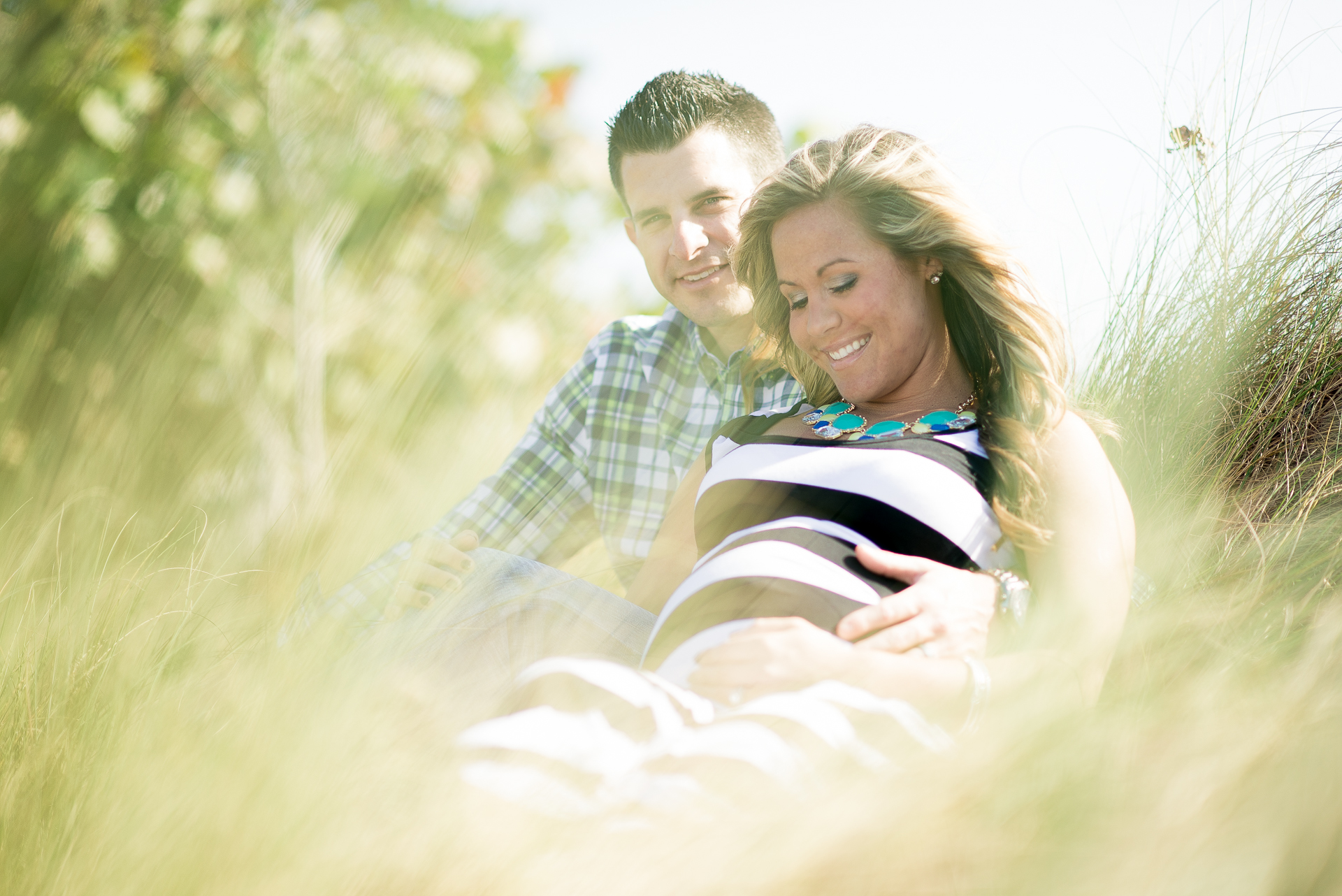 Nicole and her husband Marshal during their maternity photo shoot at blowing rocks