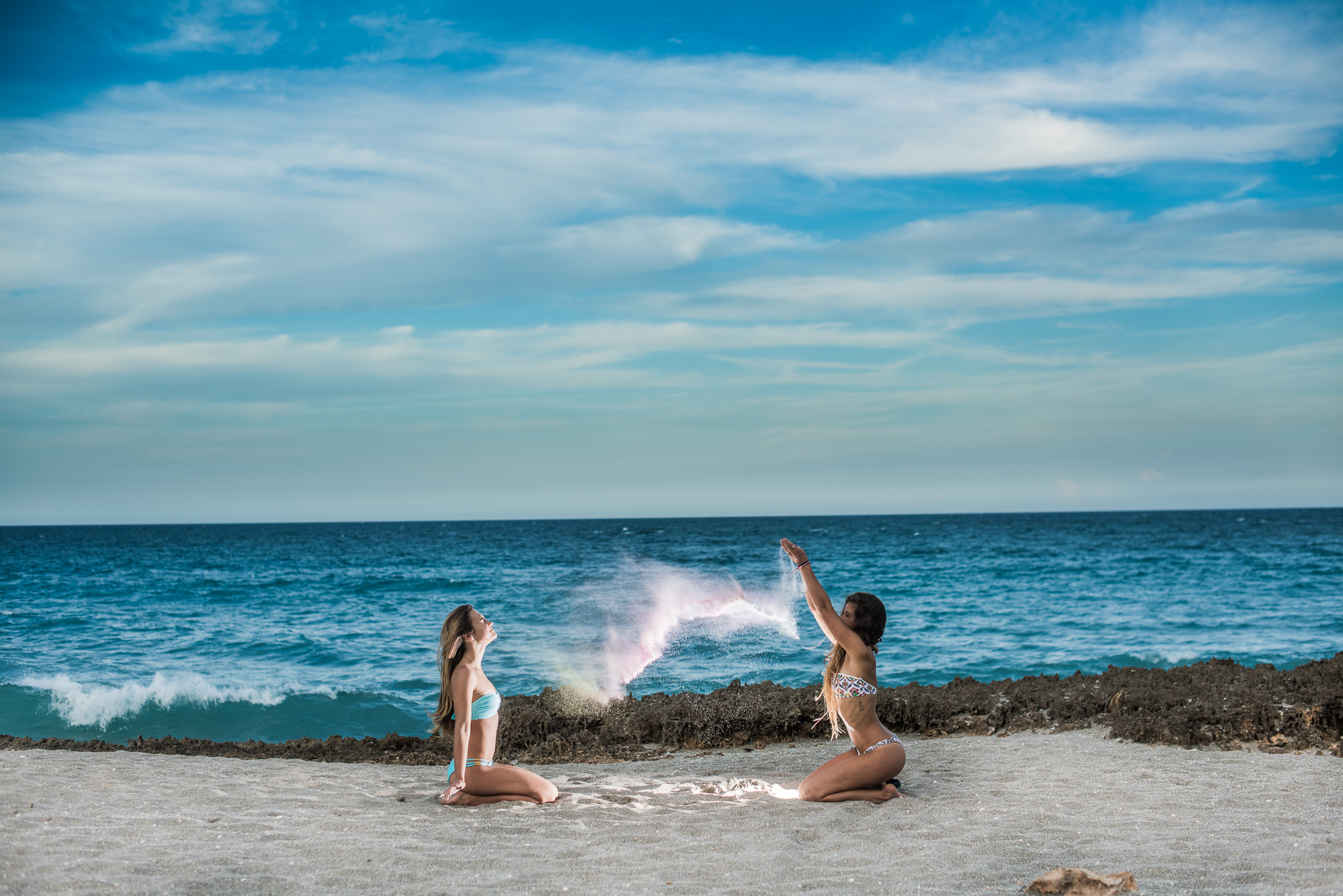 bahamasgirlblowingrocks-305.jpg