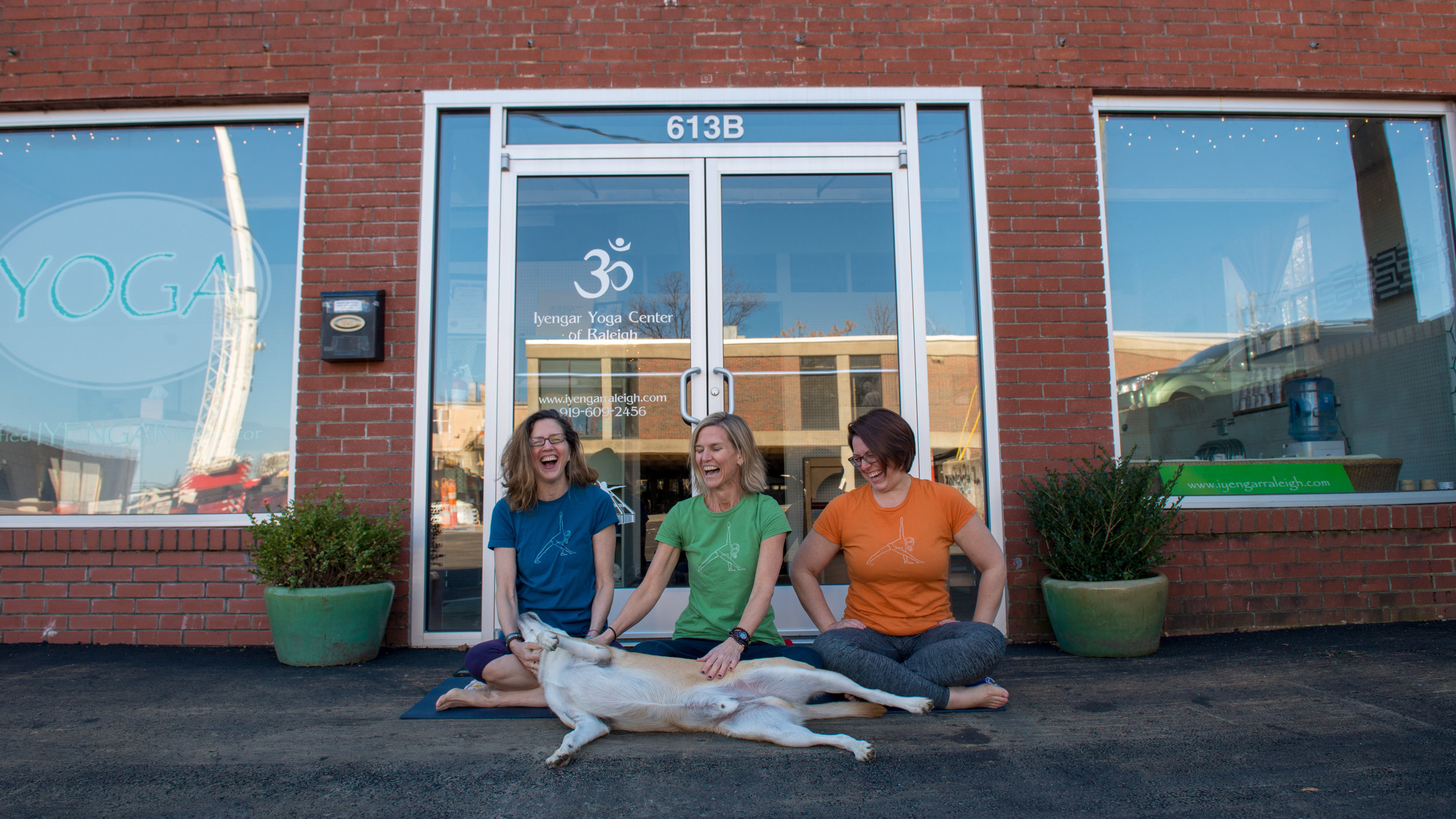 Graham, Heather and Mary Margaret have a huge love for dogs. Graham's dog Hogan enjoys joining her as she practices as well as posing in pictures during photo shoots. One of Hogan's favorite poses is lying on his back in Savasana.