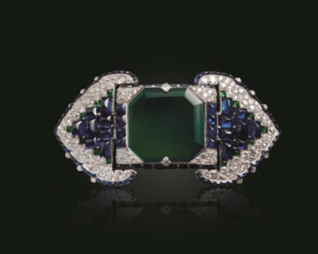 Art-deco emerald, sapphire annd diamond belt buckle by Cartier.  Photo source: christies.com