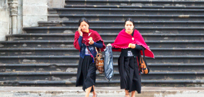 Local girls walking on a street in Quito.