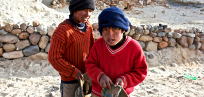 Two kids begging for food and money.