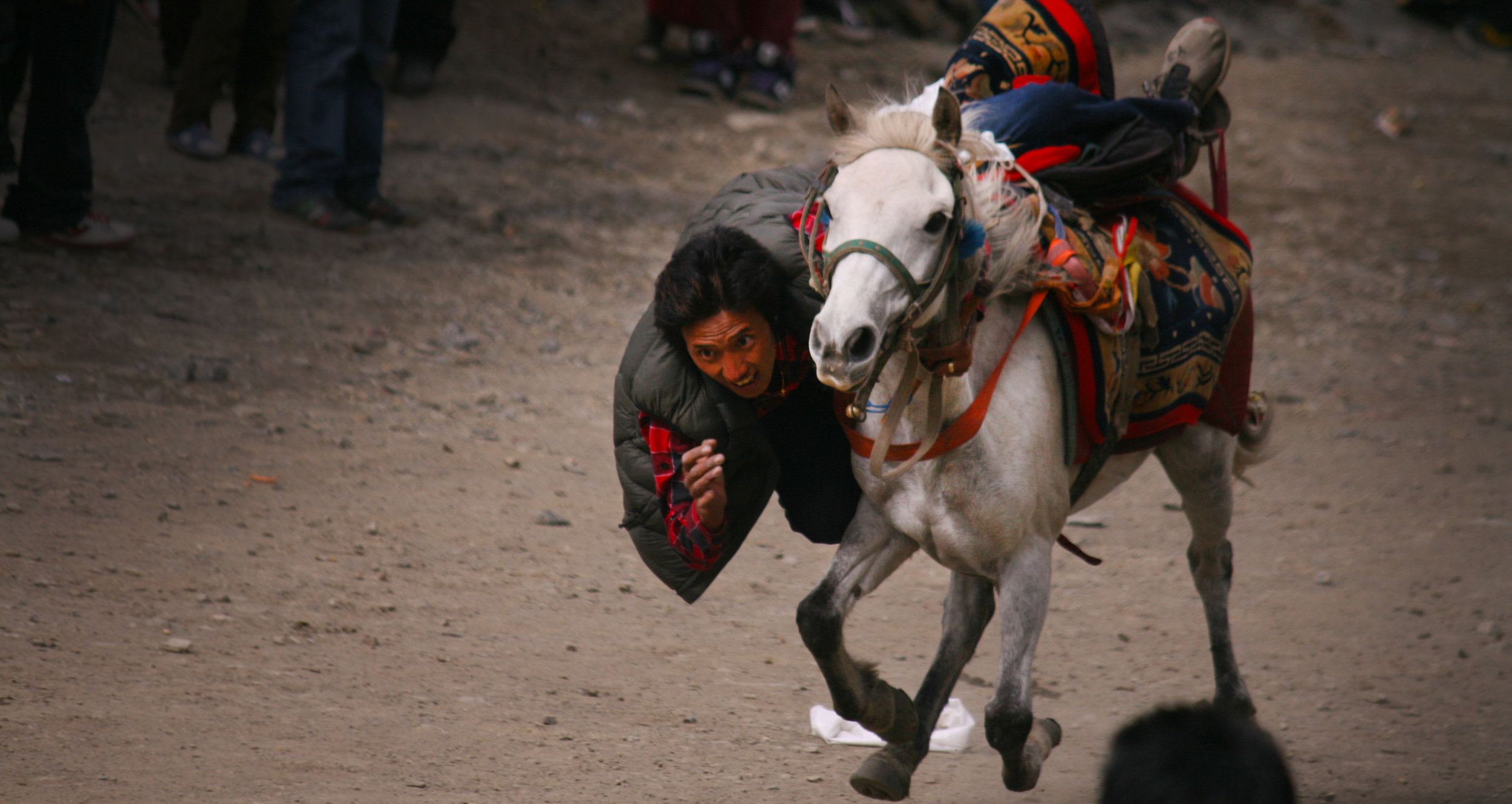 A young rider and his well balanced horse compete in a daring race in Mustang. Photo: Rajan Kathet