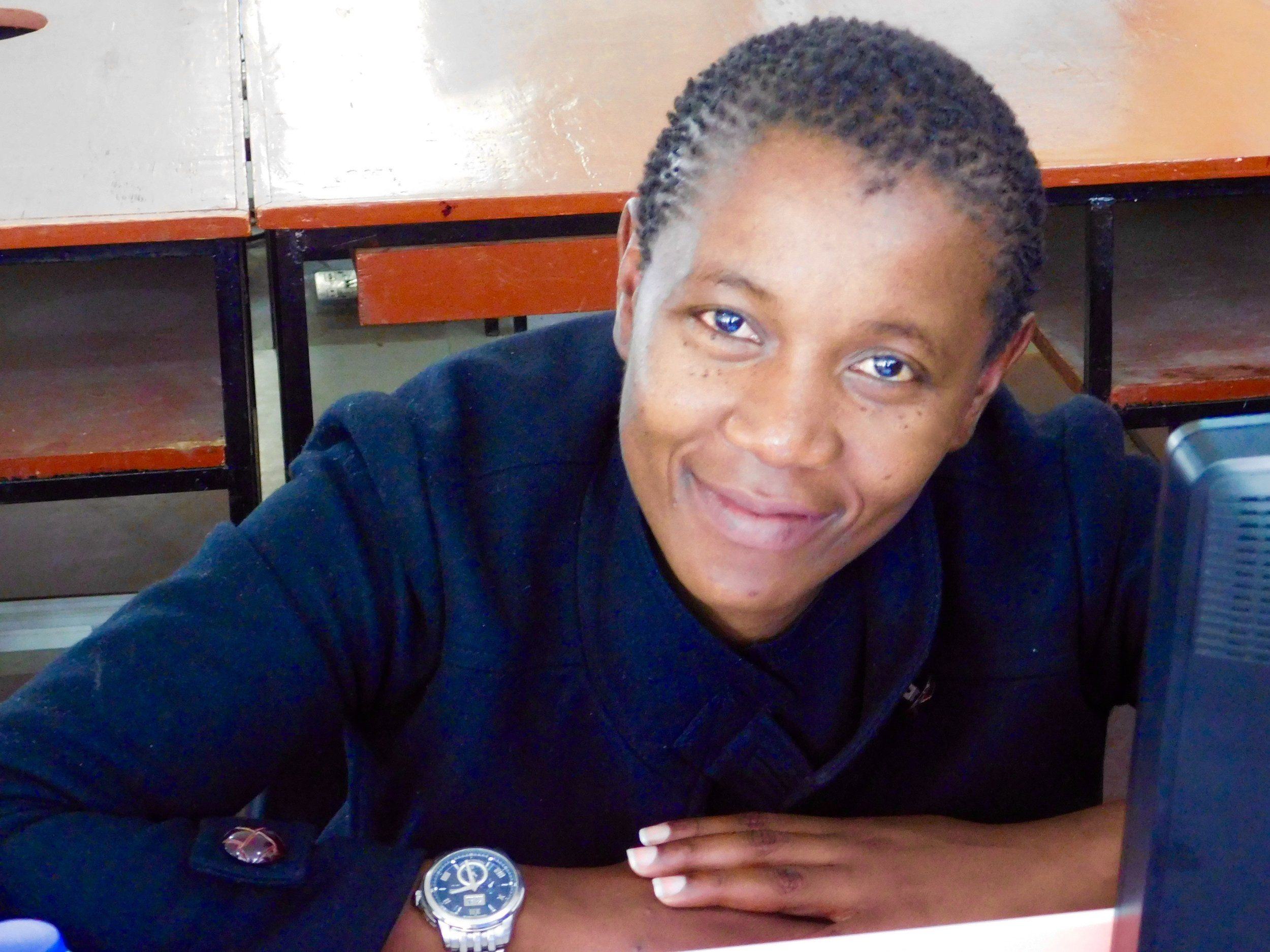 Mphatso takes a break from planning her women's dairy enterprise during the 2015 DELab.
