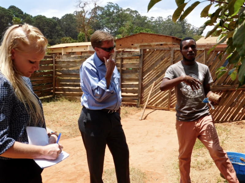 Angel, Wayne, and Sungani discuss briquette production and business strategy.