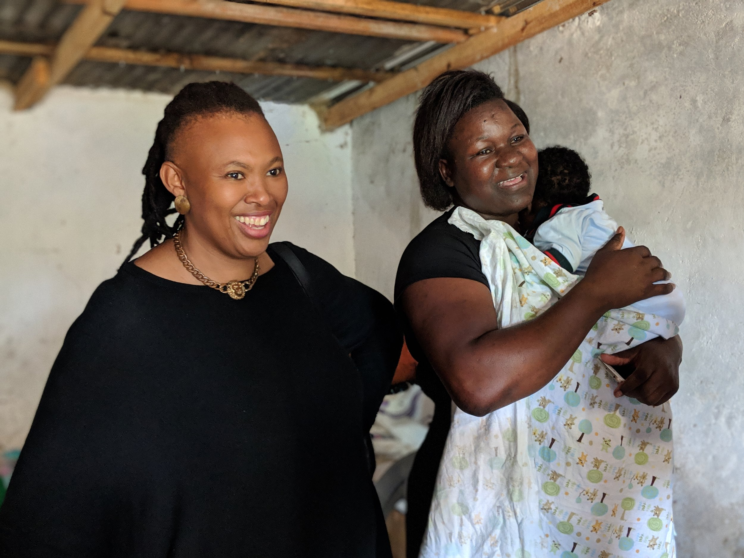 Flame Tree Initiative Fellow, Dineo Mkwezalamba (left) and social entrepreneur, Trinitas Mhango and her baby (right).