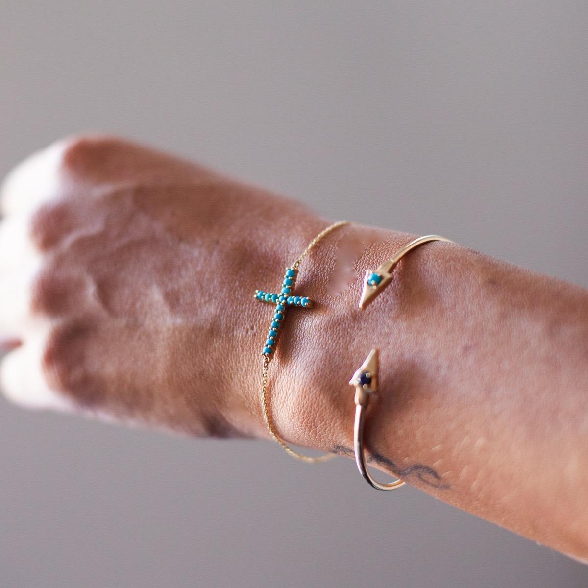 cross bracelet and arrowhead.jpg