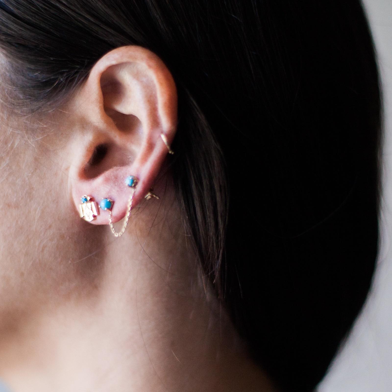 thunderbird stud and chain earring.jpg