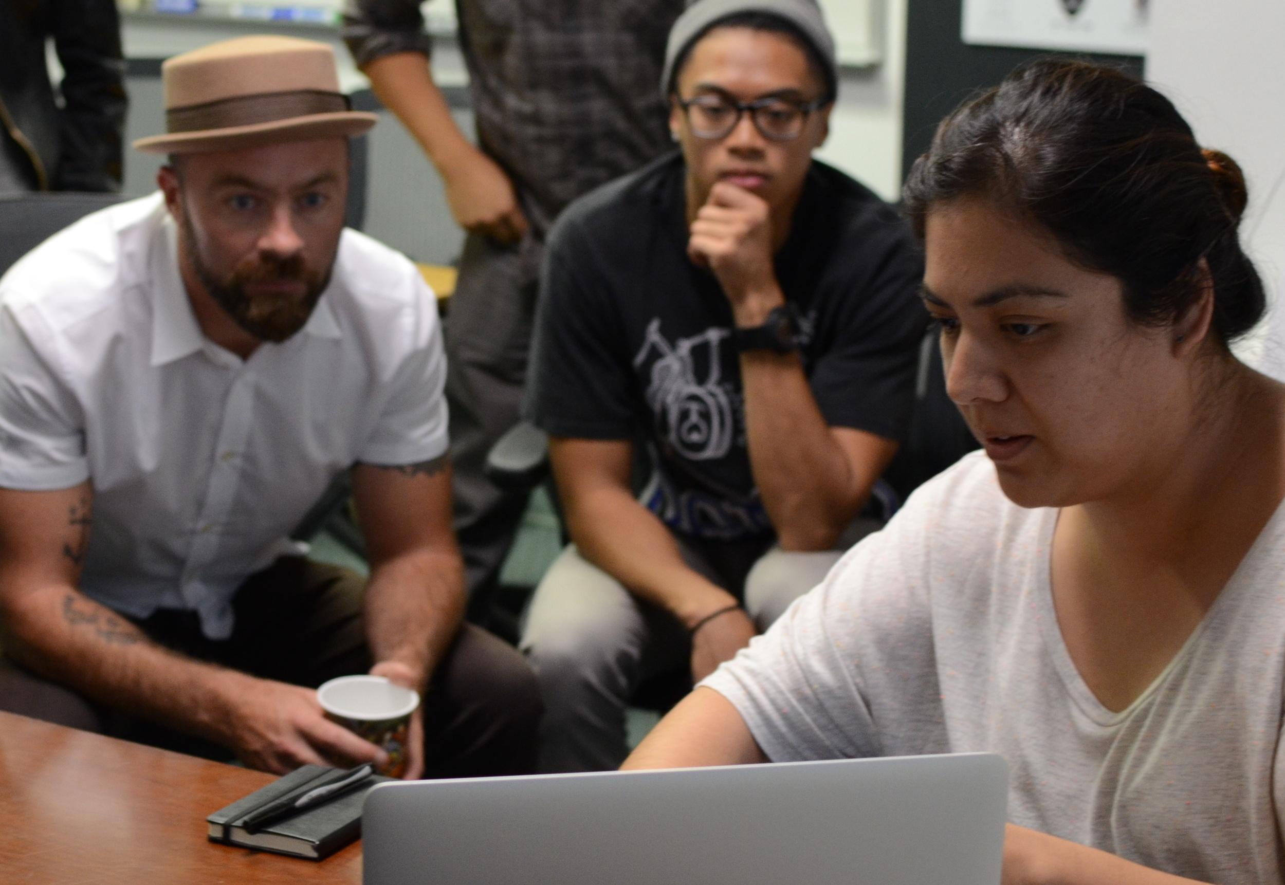 Paul (left) reviewing web design work