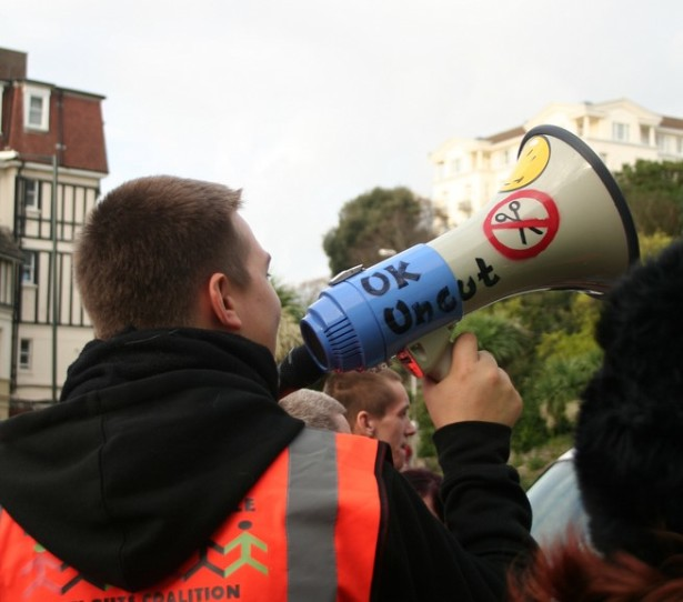 A man protests austerity and budget cuts in the United Kingdom during a massive labor strike on November 30, 2011. (Flickr/Claudia Gabriela Marques)