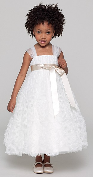 """Lulu"" is a tulle shirred strap tea length dress with fabric flower detail on the hem and oatmeal single faced satin ribbon at the waist. The dress comes in white or ivory but the trim is available in many colors!"