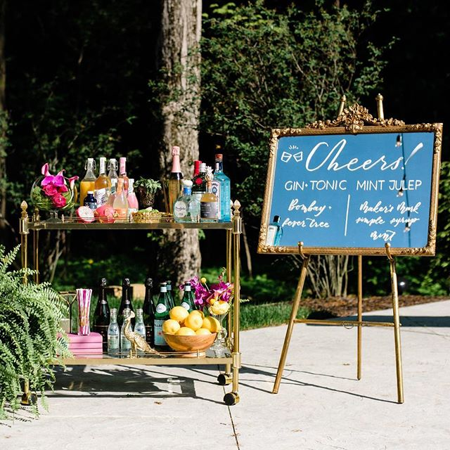 When your bar cart is perfectly in theme. 🌺🍸🍋🌈💦🍾 . . . Venue: @theestatenewalbany Photography: @styleandstory Rentals: @lostandfoundrentals Florals: @vesselfloralevents Signage: @scriptonefour Hair & MU: @thebridebar Dresses: @shopgildedsocial Suits: @pursuityourself Macrons: @honeyedconfections DJ: @joshstaleyproductions Models : @eventshelddear, @perfectlyplanned_weddings & @yourweddingperfectlyplanned, @hearenee of @aidenandgrace/@mmjevents, @trutner & @rqhartman2 of @shopgildedsocial . . . #bridesmaids #bridesmaid #614bride #columbusohio #ohiobride #columbusbride #cbusweddings #columbusweddings #bridetribe #misstomrs #pursuepretty #shoplocal #fancydress #futuremrs #engaged #isaidyes #columbusalive #expcols #asseenincolumbus #gildedtribe #styledshoot #summerwedding #cocktails #cocktailhour #weddinginspo #barsetup #gimmeallthecolor #🌈 #rainbowflowers #barcart