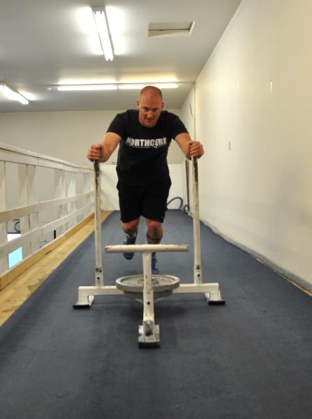 Jeff pushing the weighted sled