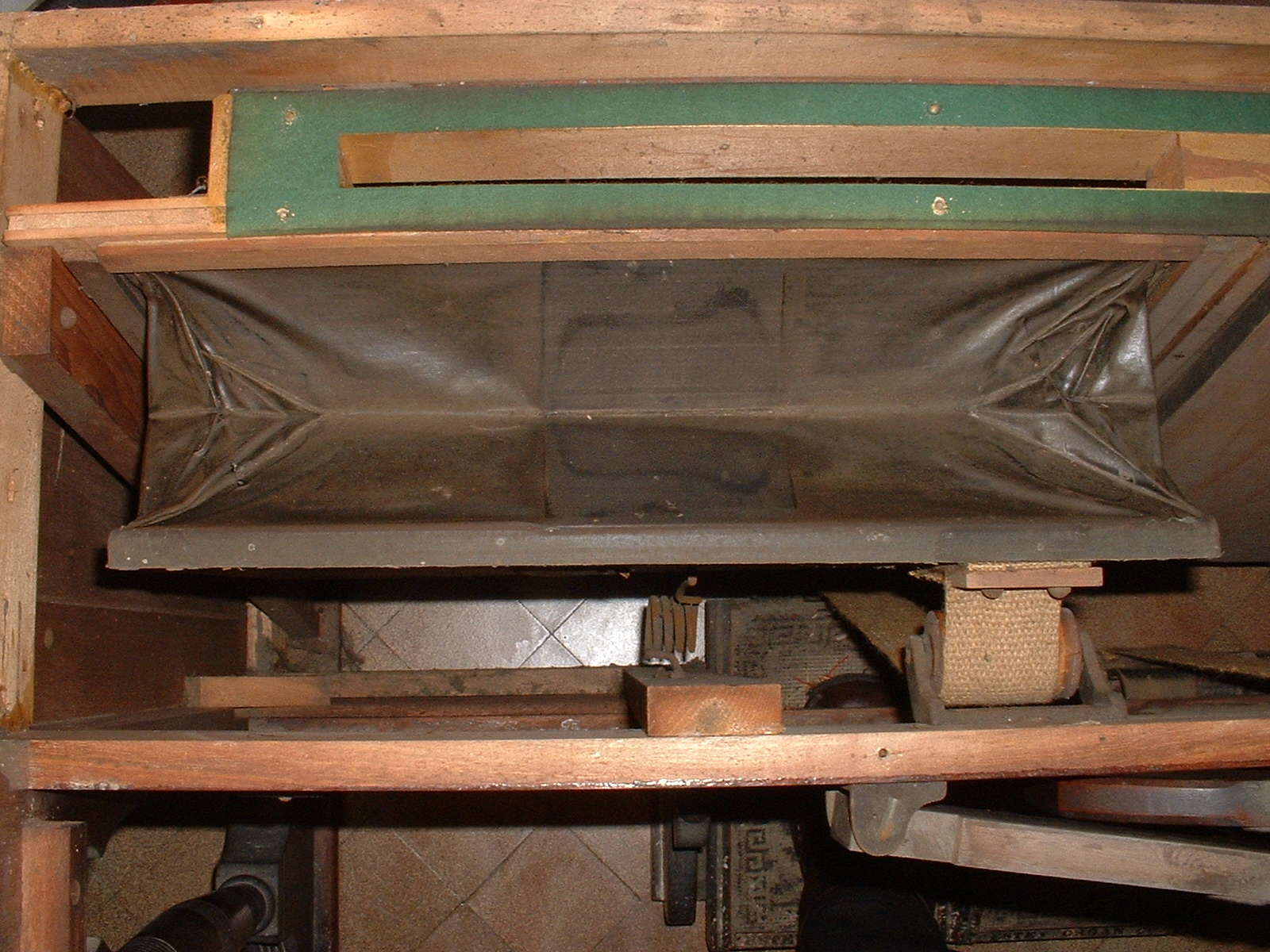 Left exhauster. Note the felt gasket at the top which I replaced with more felt. Today I would replace it with leather.