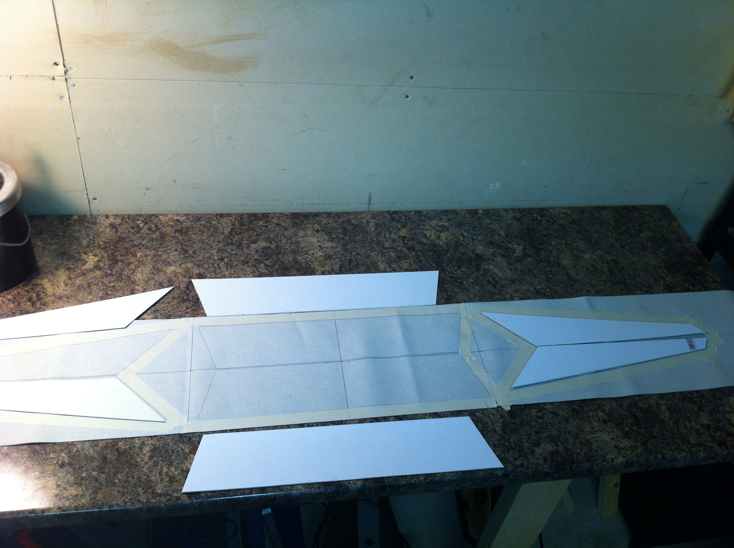 Cloth cut and marked up for an exhauster