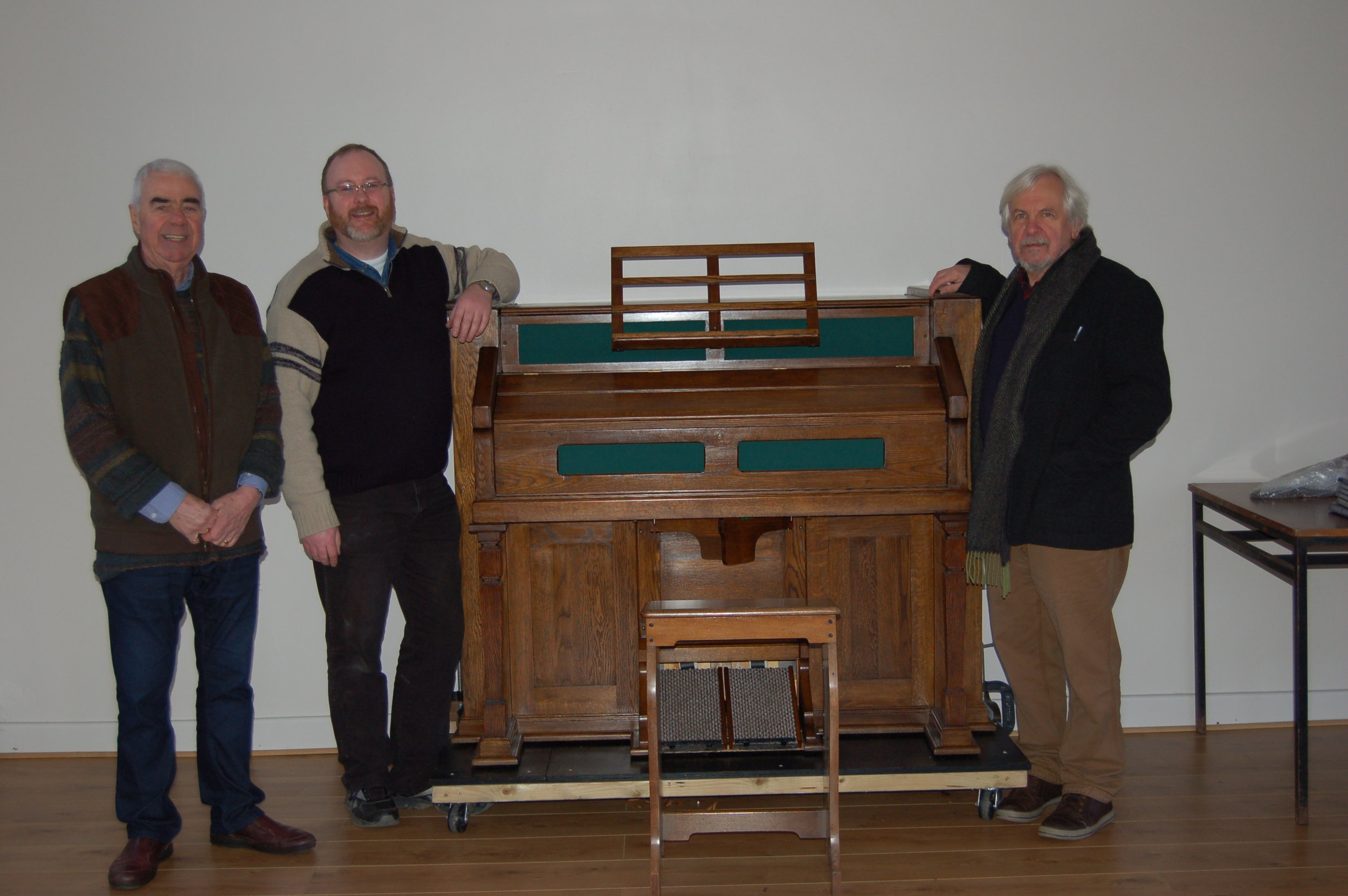 Dick, Fr. Darragh and Mick with my latest restored Estey Model O.