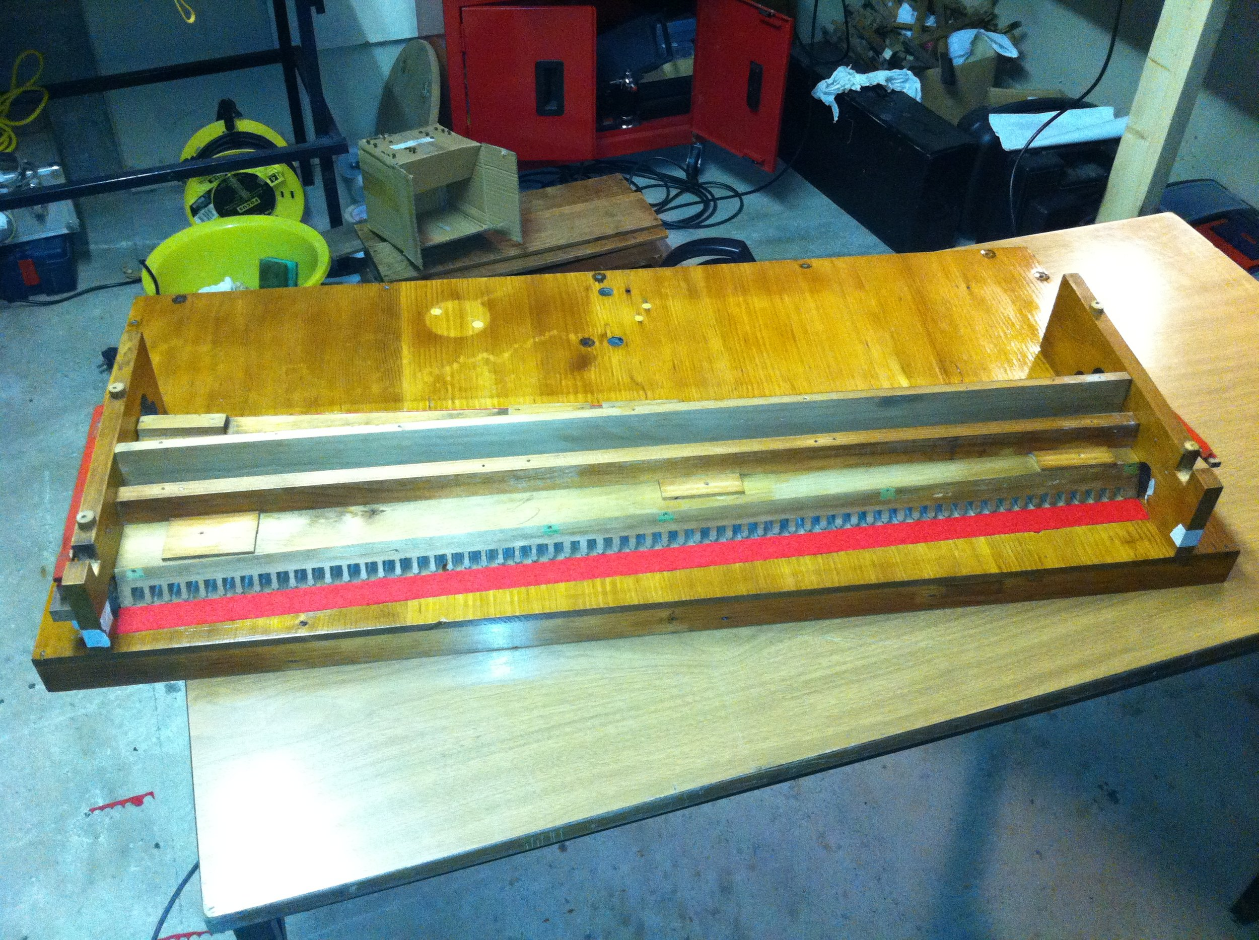 The reed pan with new reed bed felt and keyboard supports