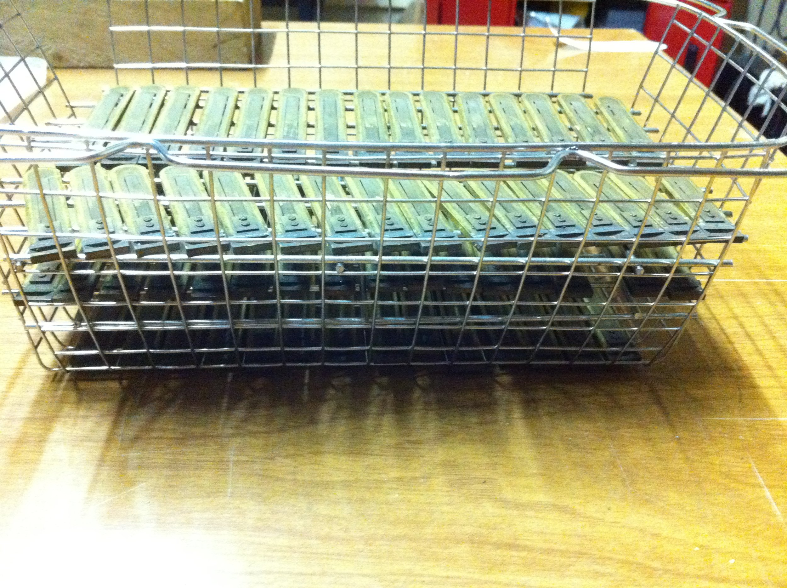 A rank of reeds in the basket ready for the ultra sonic cleaner