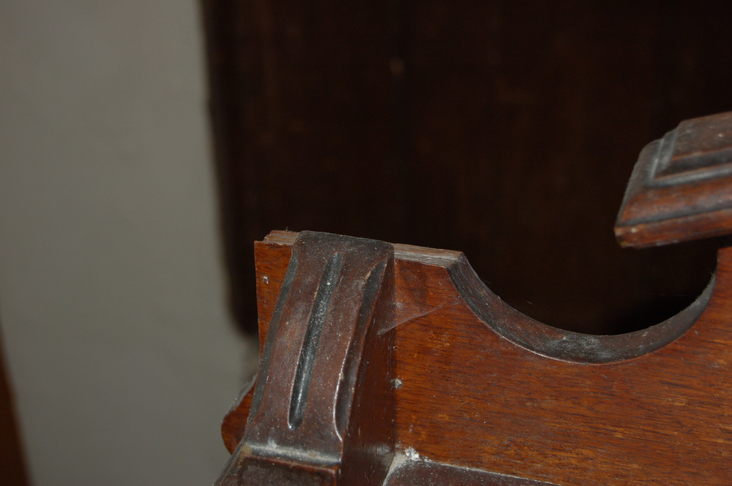 A piece was broken off the case and was repaired by John Kenny