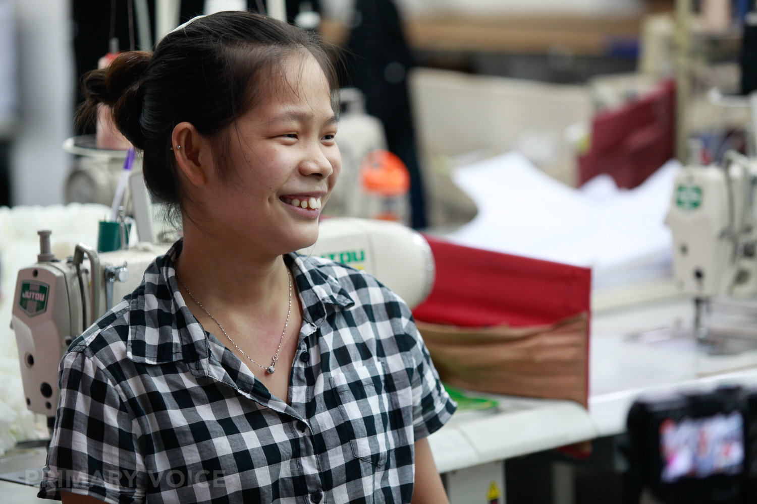 HUANG - works to save money for her own business.