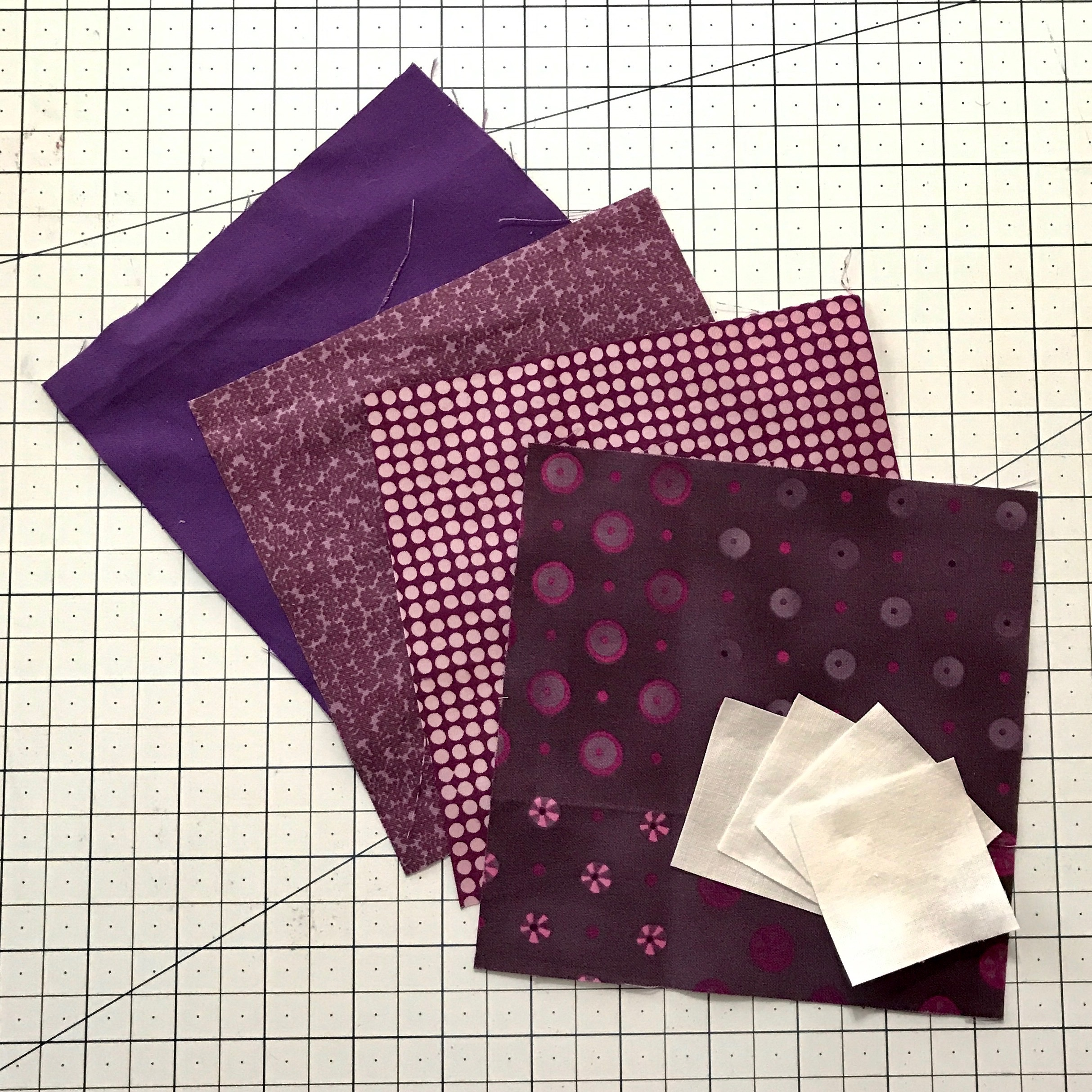 Cut four 6 inch squares and four 2 inch squares.