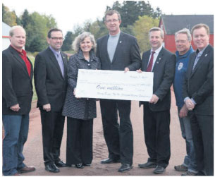 From L to R: Charlie McGeoghegan (MLA, Belfast-Murray Harbour), Robert Vessey (Ministry of Transportation and Infrastructure Renewal), Deborah Apps (president & CEO, TCT), Alan McIsaac (Ministry of Education and Early Childhood Development), Robert Henderson (Ministry of Tour  ism and Culture), Bryson Guptill (president, Island Trails), David Dunphy (Mayor, Stratford, PEI).