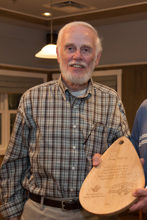 """Doug Murray being presented with a maple cutting board engraved with the words: """"Thank you for your many dedicated years as a Confederation Trail/Trans Canada Trail builder,"""" during a celebration marking the full connection of P.E.I.'s portion of the Trans Canada Trail on September 12, 2014.  Photo: Louise Vessey"""