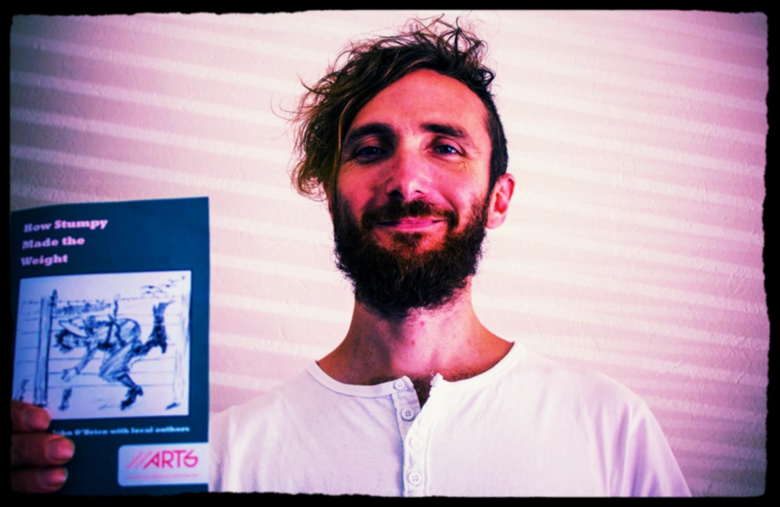 Derek-Motion-with-JOB-poetry-booklet.jpg
