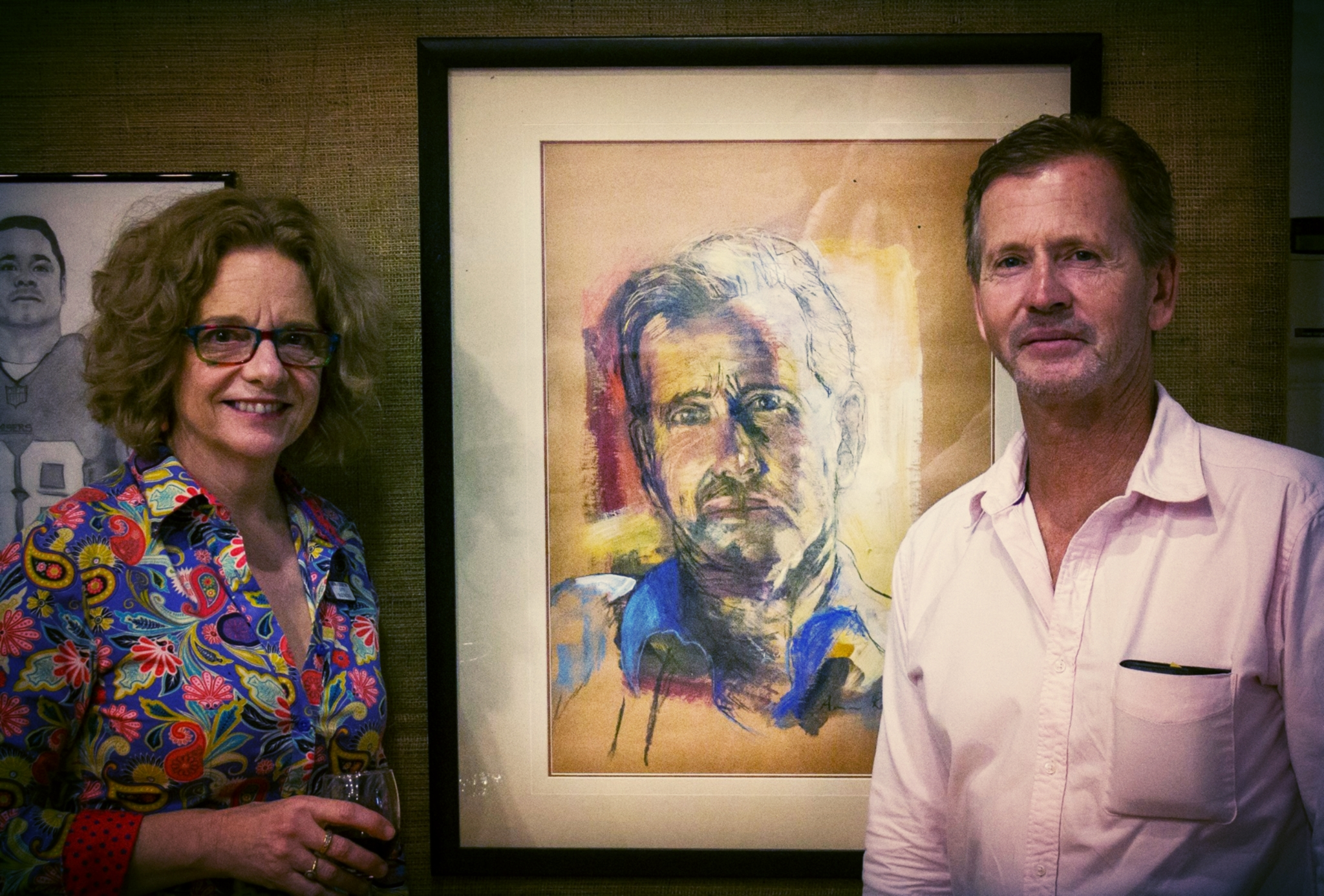 Winner 'Champion Exhibit' Ann Rayment with Model Milton Hoysted in front of 'Looking forward, looking back', charcoal, pastel and acrylic on kraft cardboard.