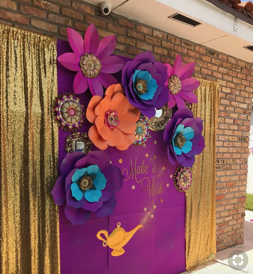 How adorable is this garage door backdrop?! Re-create this look with paper flower Butcher Paper and Sequin Curtains!