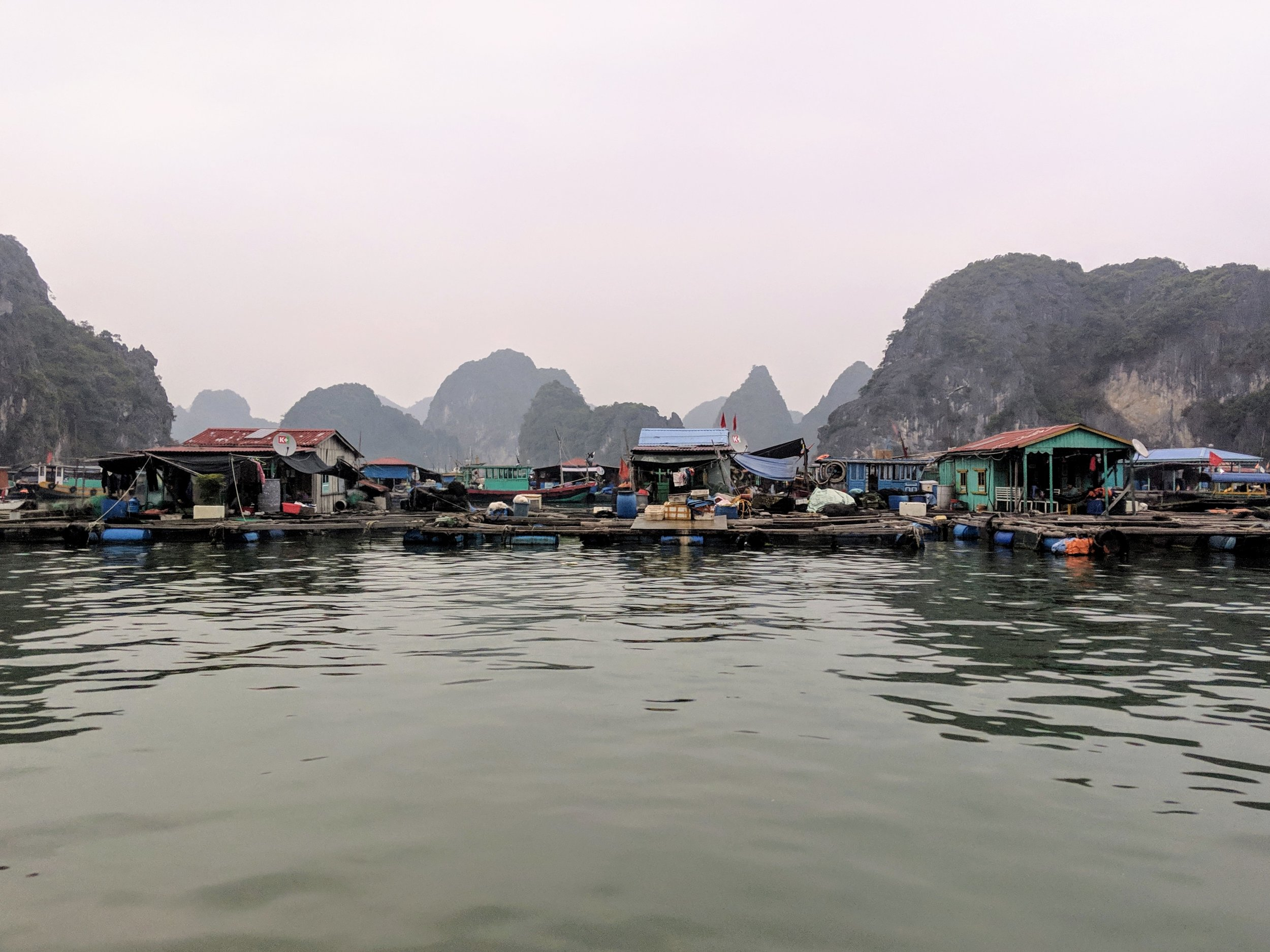 Kayaking Near Floating Houses, Cat Ba