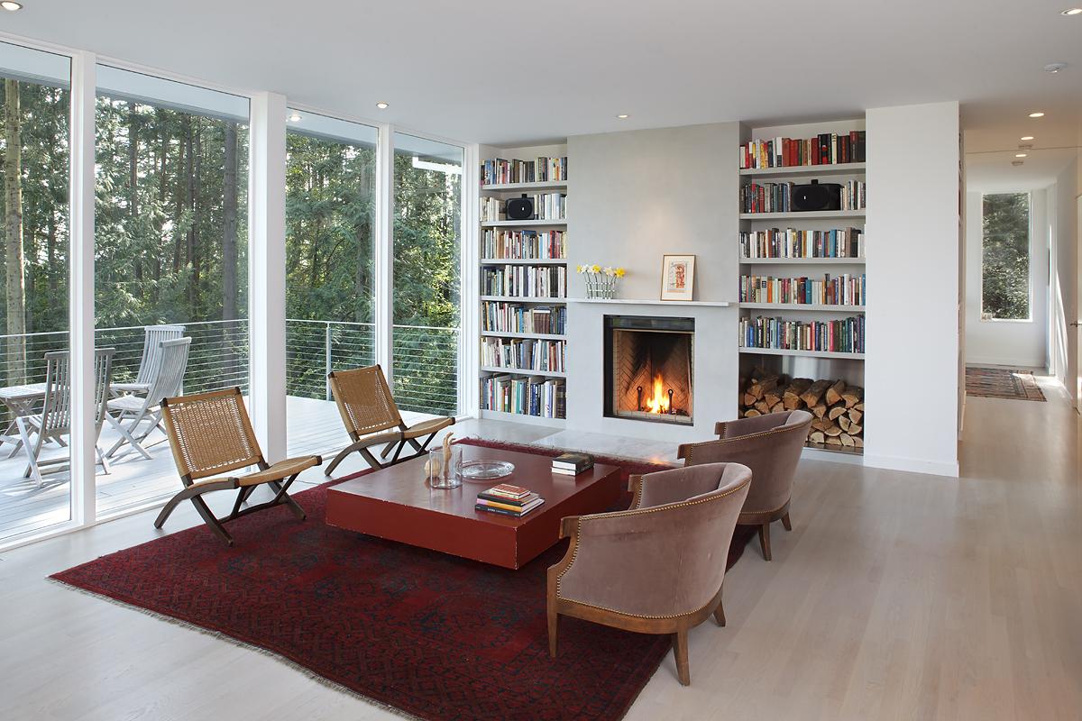 5_Living Fireplace Wall W Fire_Skagit River House.jpeg