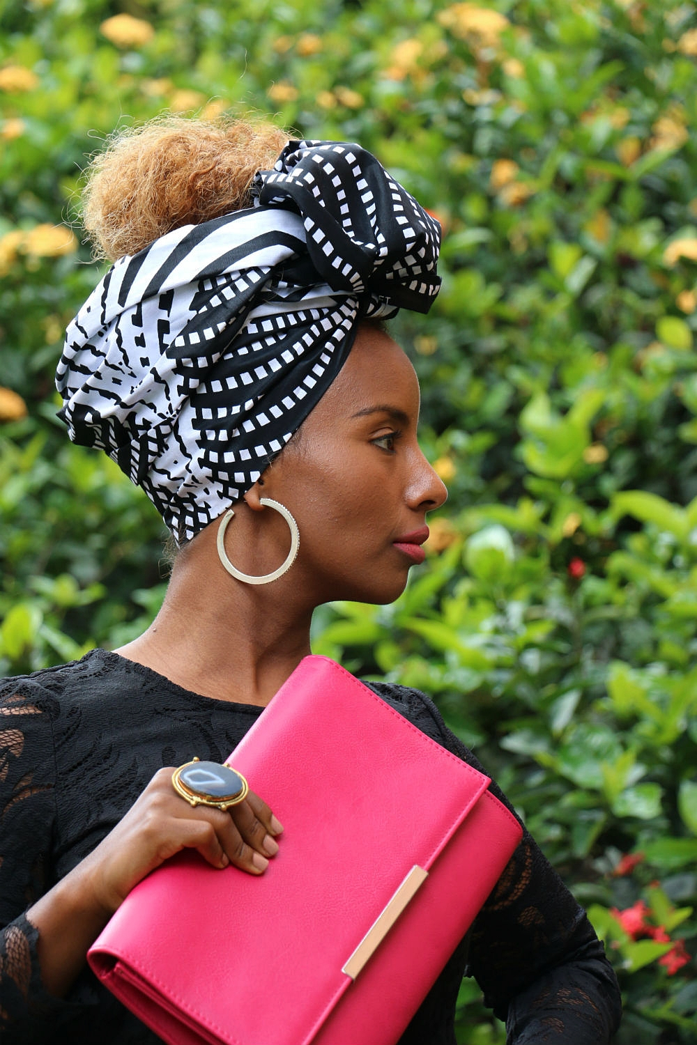 We chose a bright pink leather clutch, silver hoops and a semi-precious stone ring as accessories to compliment  headwrap GUGU.