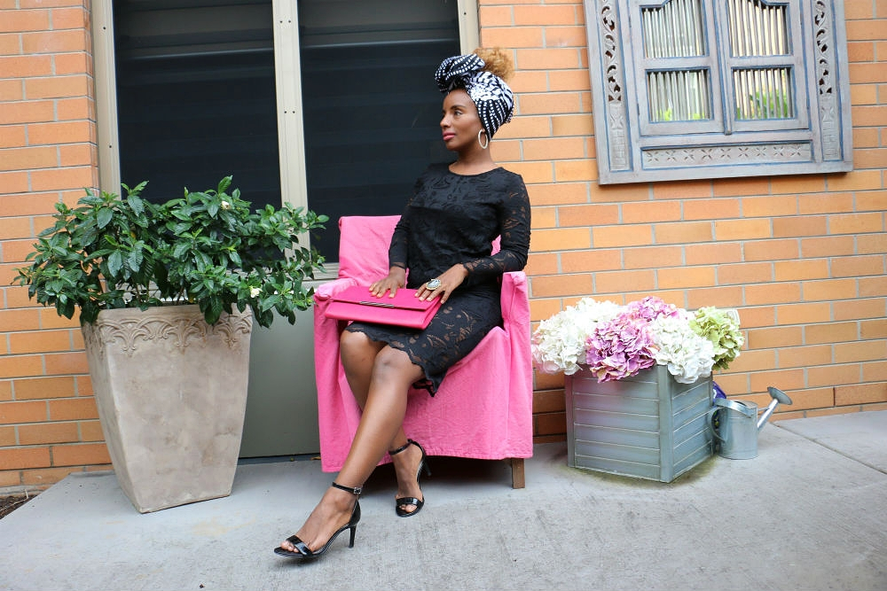 A lush green pot plant, a vintage chair covered in pink and a floral arrangement created a great backdrop for  headwrap GUGU . Black heels complete Yeni's wardrobe.