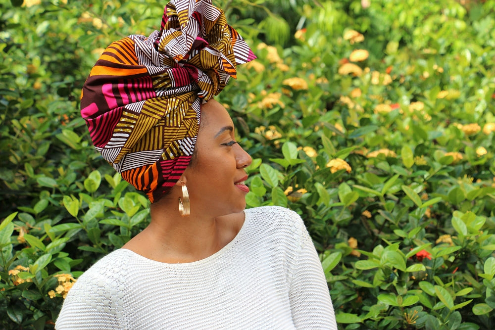 GRACEY B wears simple gold accessories to emphasise the colour palette in headwrap SHERRI.