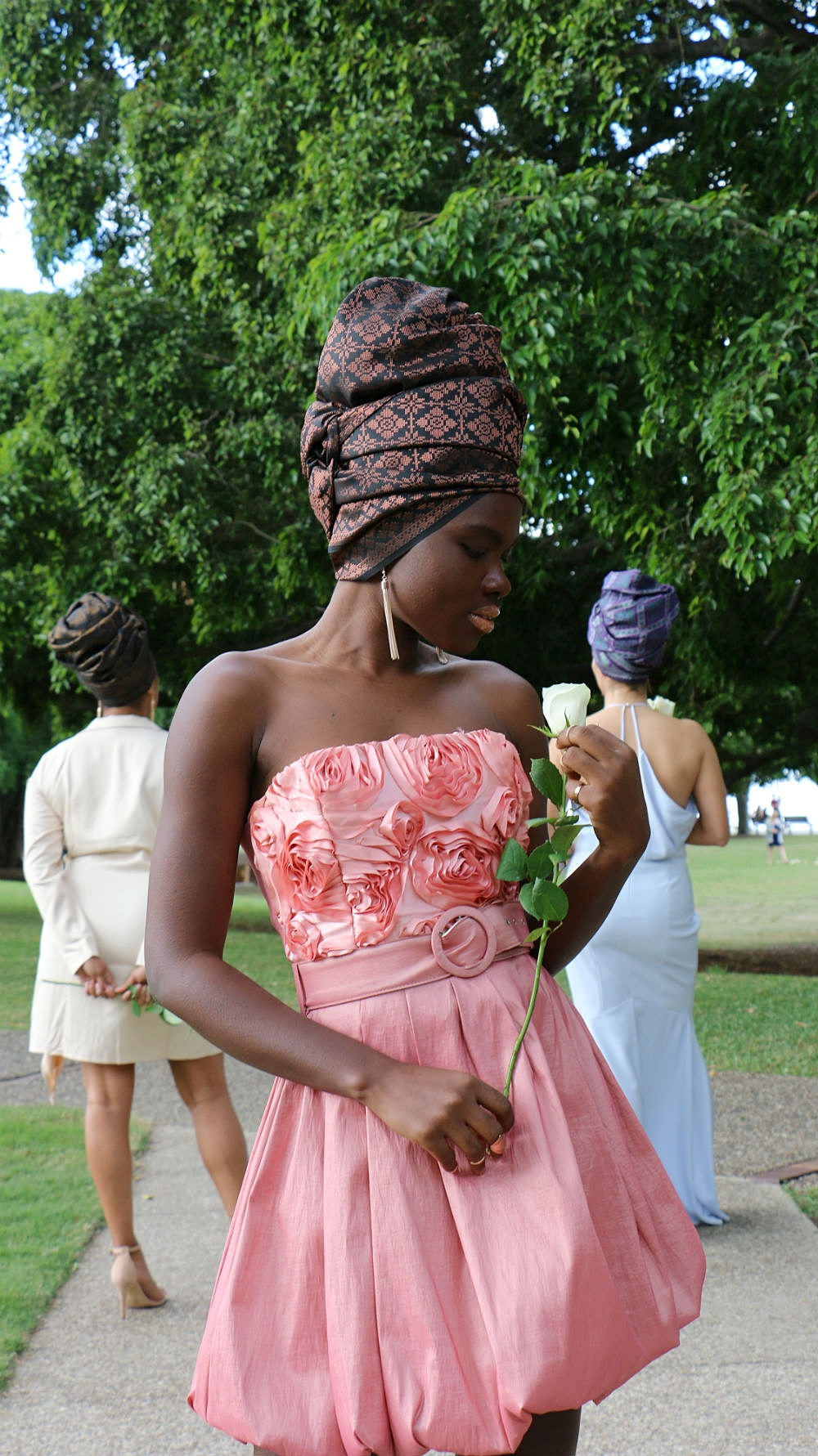 Bridesmaid or wedding guest? MARIAMA T strikes a pose in the foreground with brand ambassadors GRACEY B and DANIELA G in the background.