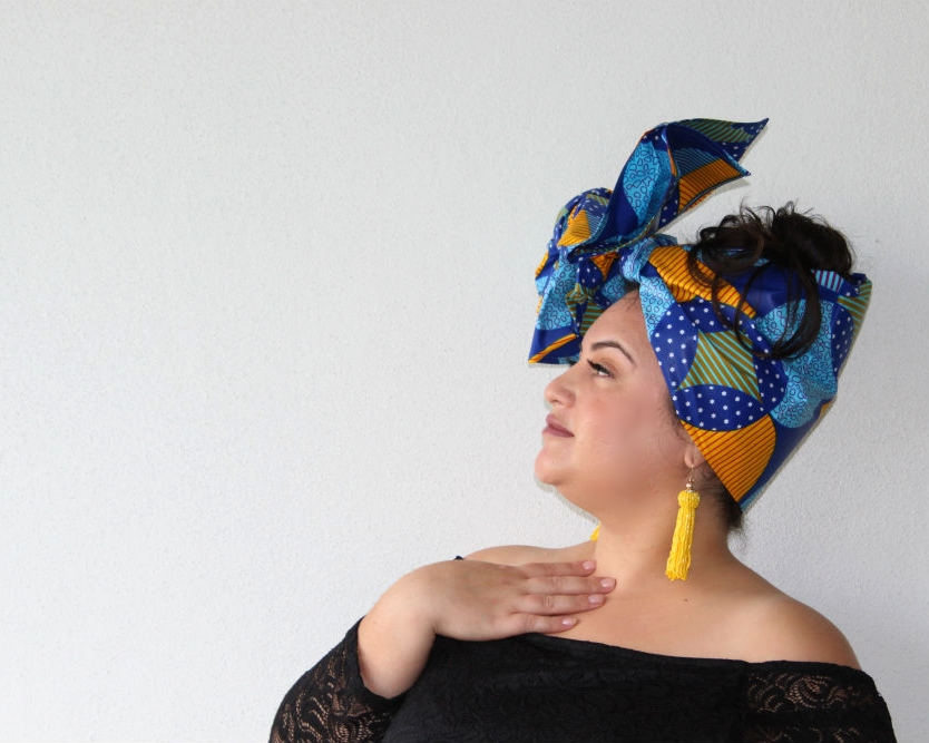 This is  headwrap JABULANI  ... bold, colourful, infused with shades of blue and a hint of yellow. Yellow coral tassel earrings and nude Nyx lip cream was all Mel needed to make this design pop.